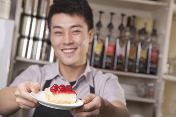 Portrait of barista serving cheesecake