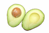 Freshly cut ripe avocado halves with seed isolated