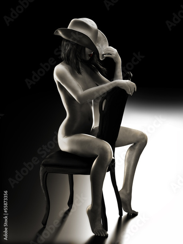 Sexy woman sitting on a chair wearing a cowboy hat © storm