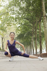 Young woman stretching in the park