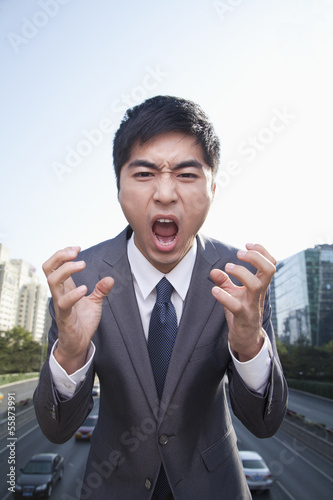 Young Angry Businessman Yelling