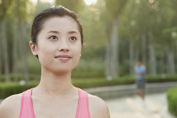Young Woman in exercise clothing in a Park, Beijing, China
