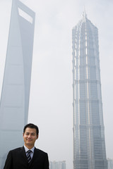 Chinese businessman near skyscrapers