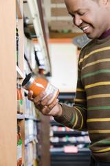 A man holding a jar