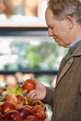 A man holding an apple