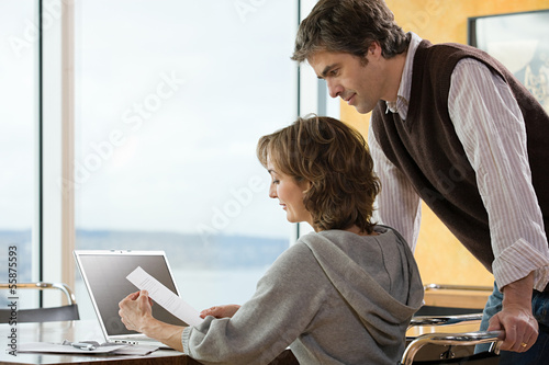 A couple looking at paperwork