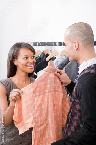 Man and woman in clothes shop