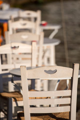 Close-up from a white chair and white table.