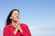 Mature friendly woman Meditating and praying