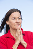 Relaxed concentrated woman praying hands poster
