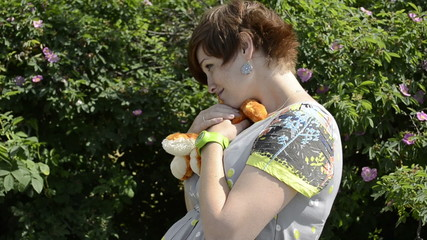 Pregnant woman with plush toy fox