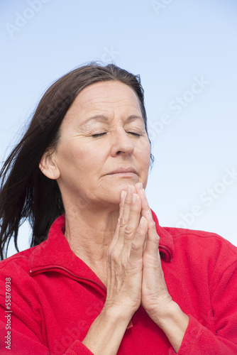 Praying woman relaxed and closed eyes