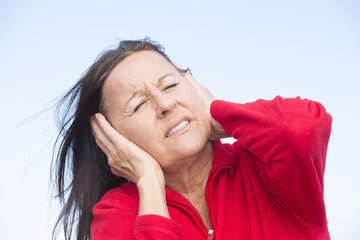 Stressed worried woman with hands on ears