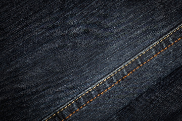 Denim texture, background. Shallow depth of field.