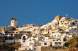 Windmill and different hotels at Oia