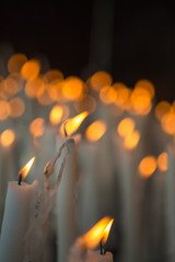 Candles burning in the church of Lourdes