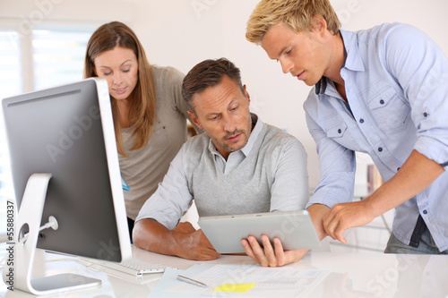 Business people in office working on desktop