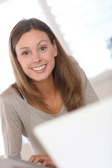 Portrait of smiling woman working on laptop