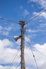 electrical post by the road with power line cables