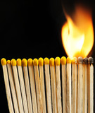 burning matchsticks on black background
