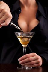 Barmaid mixing drink
