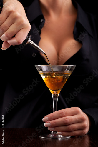 Barmaid mixing drink