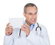 Doctor holding prescription note
