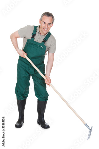 Male Gardner With Gardening ToolВ