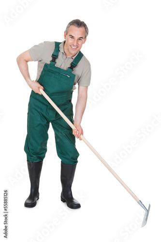Male Gardner With Gardening ToolВ