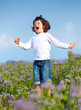 Young boy jumping in the field III