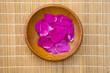 wild rose eglantine petals in wooden  plate