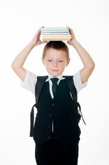 little boy with books on head on white background