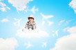 Boy sitting on cloud