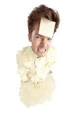 Wide angle photo of young male with a sticky note