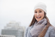 Cheerful cute brunette with winter clothes on posing