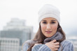 Cold cute woman with winter clothes on posing