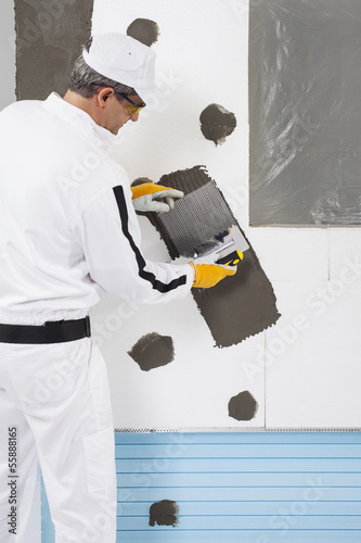 Worker reinforcing a window frame
