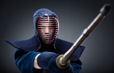 Portrait of kendoka with bamboo sword