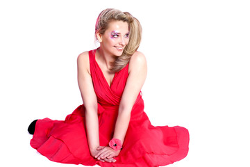 smiling woman in a red dress with original make-up