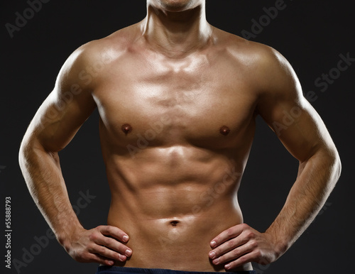 Close up of sexy male's chest, isolated on black