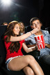Woman Feeding Popcorn To Boyfriend In Theatre