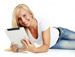 Pretty women works with tablet pc on the floor