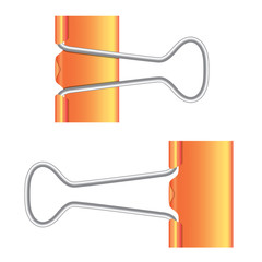 Binder clips. Orange paper clip. Real icon.