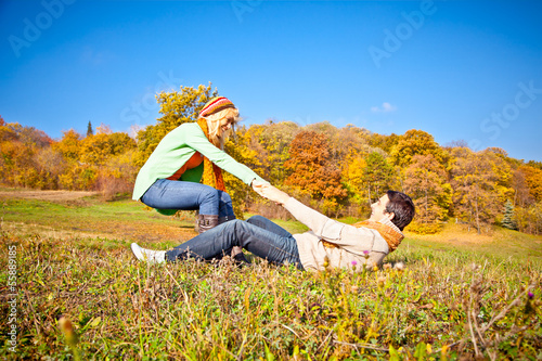 Young romantic couple have a fun in park.