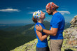 Caucasian couple takes rest on top of mountain