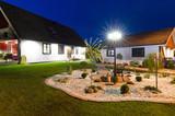 Fototapety Villa with modern garden - night view