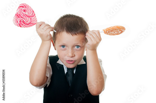 little boy with big candy on white background