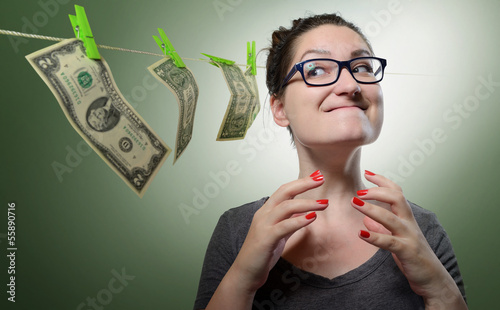 Sarcastic girl dreams of many money. Concept total greed