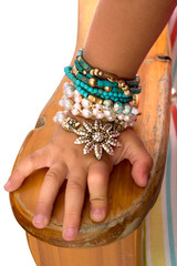 Little Girls Hand with Beads and Bracelets