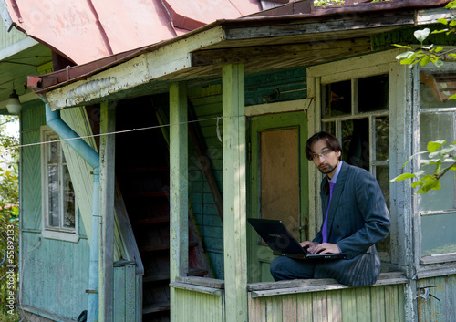 business man using laptop in the field